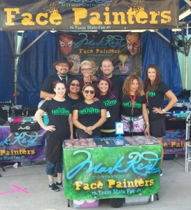 Mark Reid's Face Painting Booth at the Texas State Fair is non stop because their awesome designs can be seen from the midway