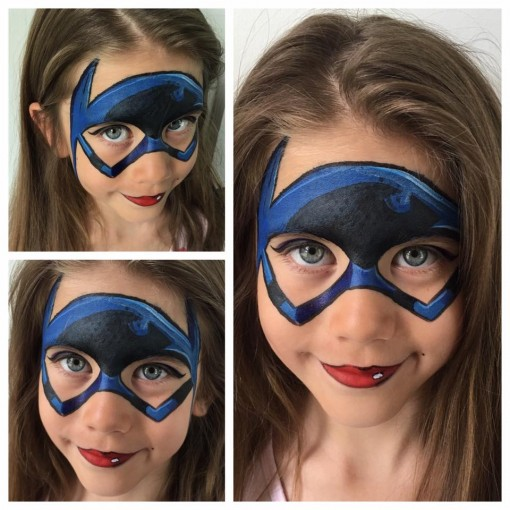 Batman isnt just for boys. Girls can rock a super cool batgirl lipstick and all! Great work by New Creation Face and Body Art