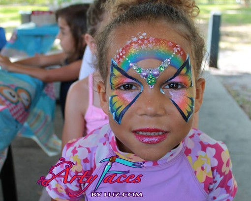 Art faces by Luz hit a home run with rainbows, bling and butterfly