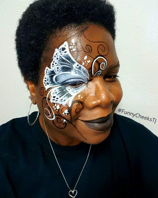 Anyone who can paint this awesome on their own face deserves a special place in our hearts! Great job by Teretha FunnyCheeks